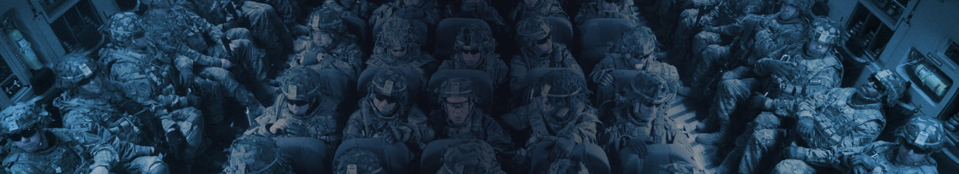 Fall3nWarrior Gaming Support Us Page Header Background soldiers sigting in rows of seats inside an aircraft cargo hold.